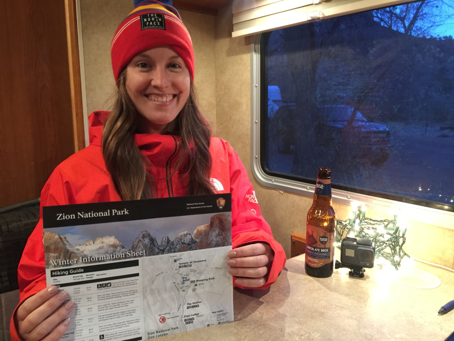 Holding Zion National Park flyer in rental RV