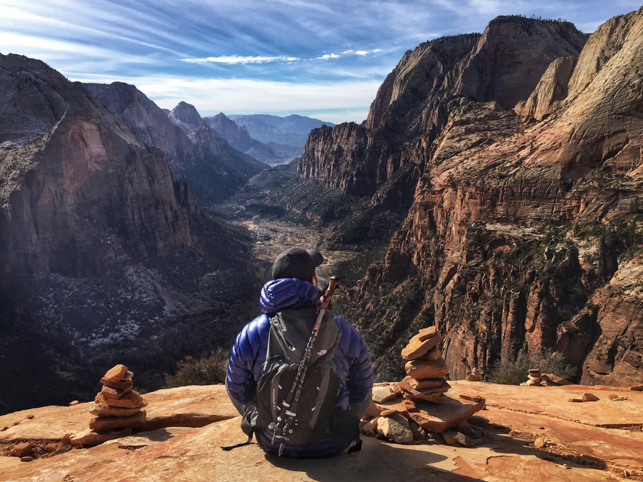 resting at the summit of Angel's Landing in Zion National Park.