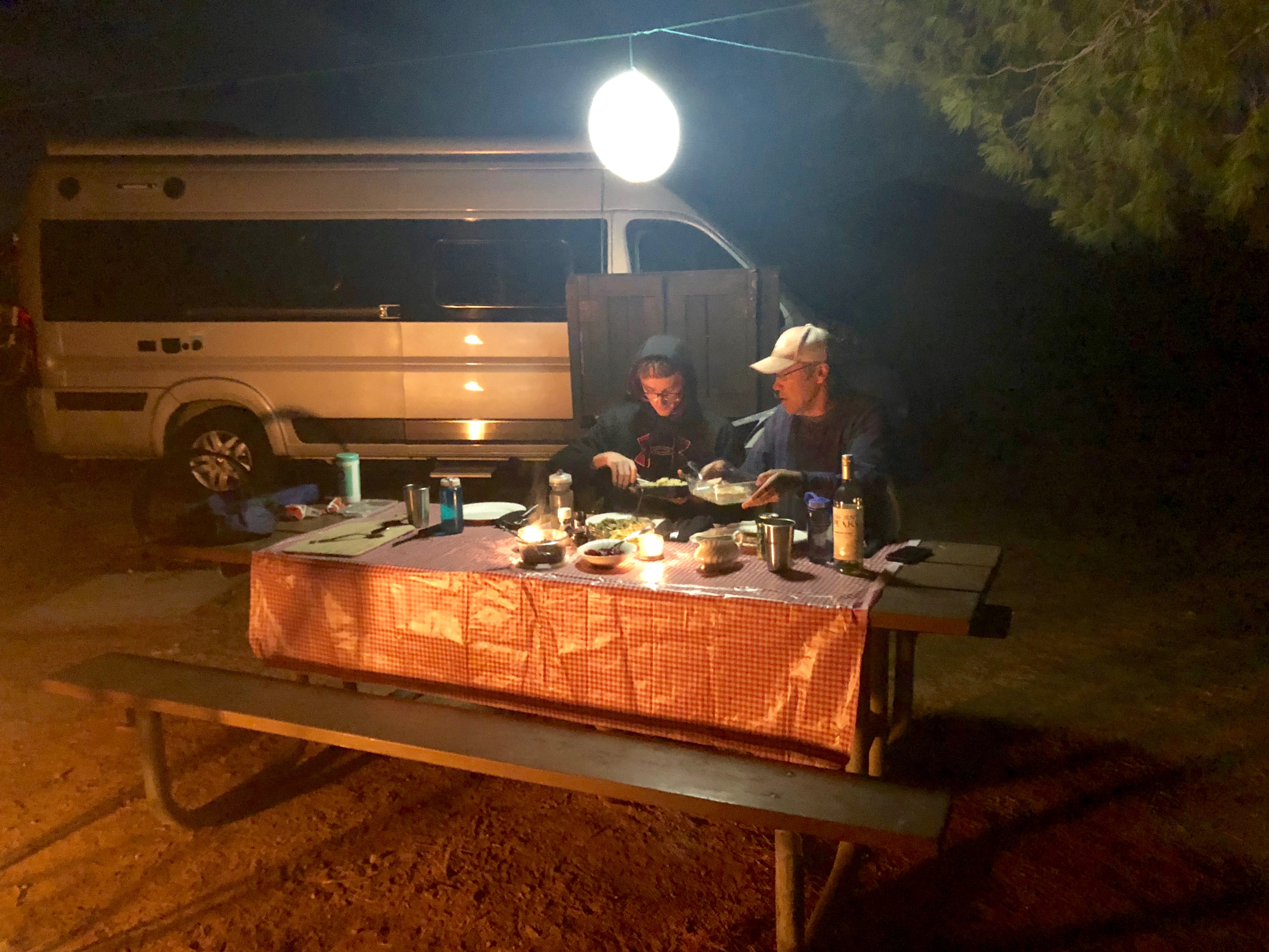 Solar glob strung over campground dinner table