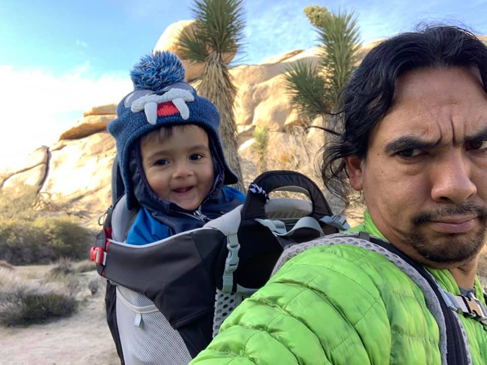 Toddler enjoying hike in kid carrier